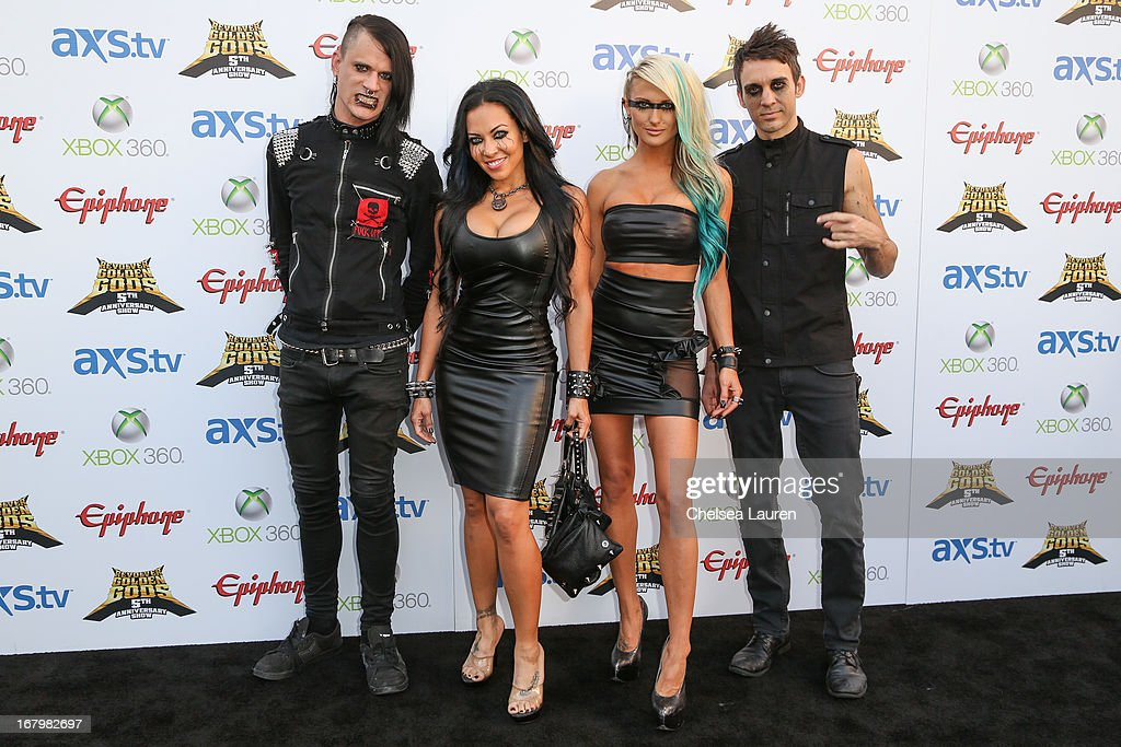 Musicians Chris Warner, <a gi-track='captionPersonalityLinkClicked' href=/galleries/search?phrase=Carla+Harvey&family=editorial&specificpeople=8535893 ng-click='$event.stopPropagation()'>Carla Harvey</a>, <a gi-track='captionPersonalityLinkClicked' href=/galleries/search?phrase=Heidi+Shepherd&family=editorial&specificpeople=8535891 ng-click='$event.stopPropagation()'>Heidi Shepherd</a> and Henry Flury of Butcher Babies arrive at the 5th Annual Revolver Golden Gods awards show at Club Nokia on May 2, 2013 in Los Angeles, California.