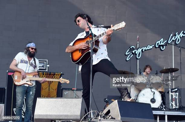 Musicians Chris Zasche Jonathan Russell and Tyler Williams of The Head and the Heart perform on the Coachella Stage during day 2 of the Coachella...