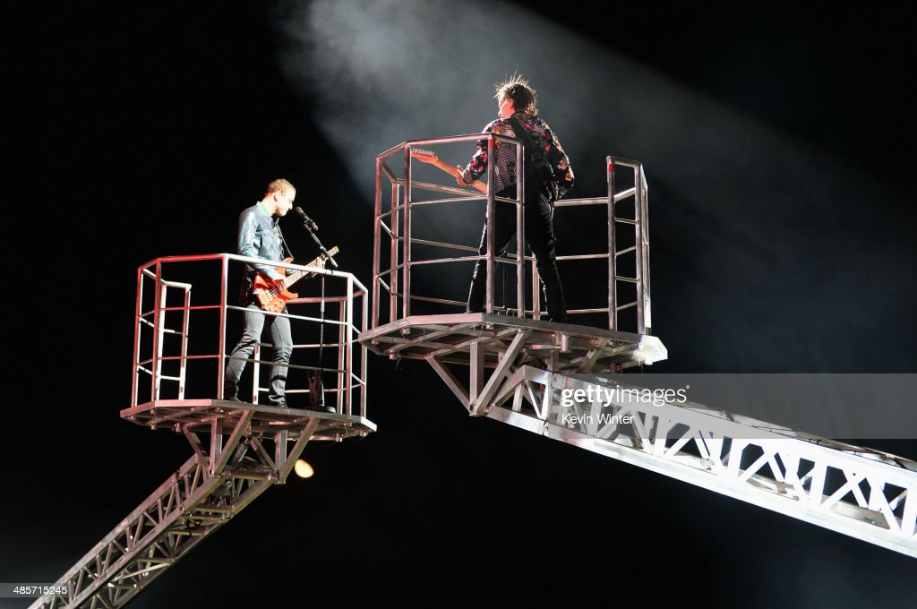 Musicians Christopher Wolstenholme (L) and <a gi-track='captionPersonalityLinkClicked' href=/galleries/search?phrase=Matthew+Bellamy&family=editorial&specificpeople=225046 ng-click='$event.stopPropagation()'>Matthew Bellamy</a> of Muse perform onstage during day 2 of the 2014 Coachella Valley Music & Arts Festival at the Empire Polo Club on April 19, 2014 in Indio, California.