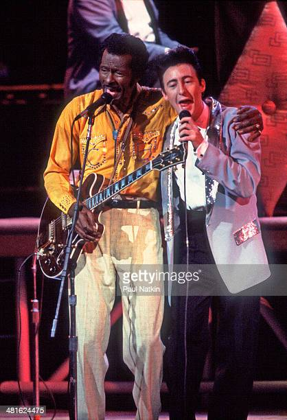 Musicians Chuck Berry and Julian Lennon perform onstage at the Fox Theater during the filming of the movie 'Hail Hail Rock 'n' Roll' St Louis...