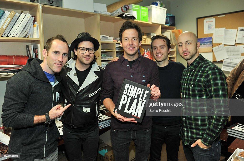 Musicians Chuck Comeau David Desrosiers Pierre Bouvier Sebastien Lefebvre and Jeff Stinco attend 'Simple Plan The Official Story' book signing at...