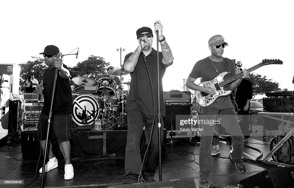 Musicians Chuck D, B-Real and Tom Morello of Prophets of Rage perform outside of the California Rehabilitation Center on August 10, 2016 in Norco, California.