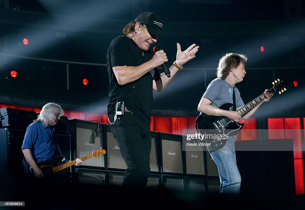 Musicians Cliff Williams, Brian Johnson and Angus Young of AC/DC rehearse onstage during The 57th Annual GRAMMY Awards at the Staples Center on February 6, 2015 in Los Angeles, California.