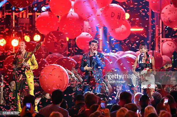 Musicians Cole Whittle Joe Jonas and JinJoo Lee of DNCE perform onstage during the 2016 Billboard Music Awards at TMobile Arena on May 22 2016 in Las...