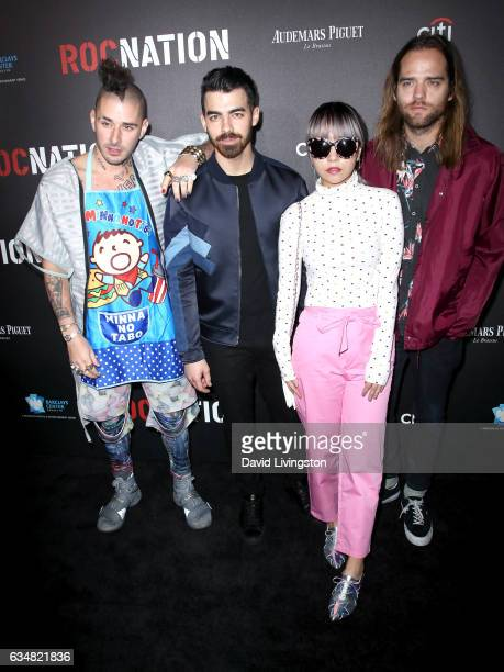 Musicians Cole Whittle Joe Jonas JinJoo Lee and Jack Lawless of DNCE attends Roc Nation's PreGRAMMY Brunch on February 11 2017 in Los Angeles...