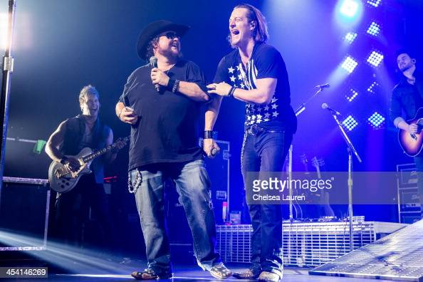 Musicians Colt Ford and Tyler Hubbard of Florida Georgia Line perform at Club Nokia on December 6 2013 in Los Angeles California