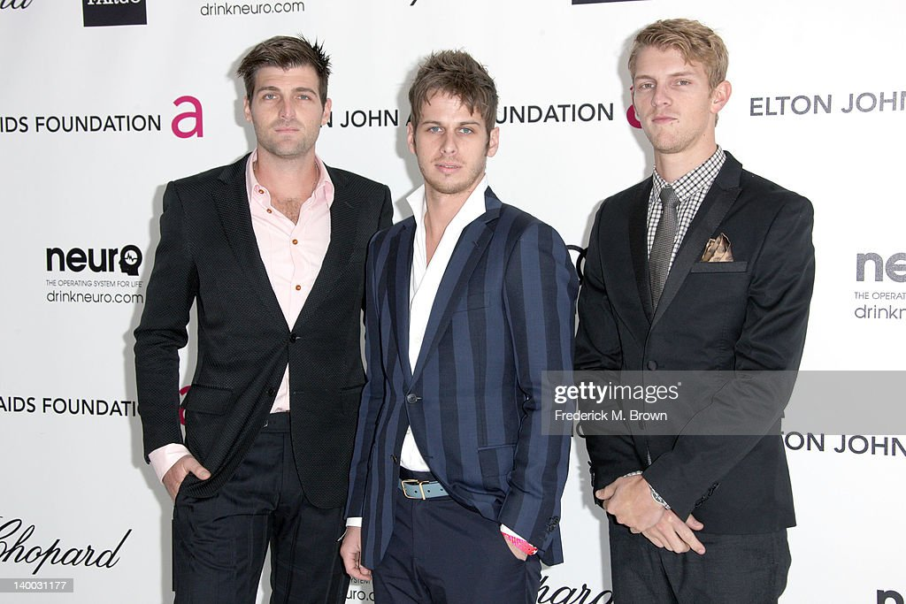 Musicians Cubbie Fink Mark Foster and Mark Pontius of the music group Foster The People arrives at the 20th Annual Elton John AIDS Foundation's Oscar...