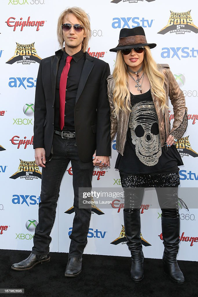 Musicians Cyril Niccolai (L) and <a gi-track='captionPersonalityLinkClicked' href=/galleries/search?phrase=Orianthi&family=editorial&specificpeople=4436929 ng-click='$event.stopPropagation()'>Orianthi</a> arrive at the 5th Annual Revolver Golden Gods awards show at Club Nokia on May 2, 2013 in Los Angeles, California.
