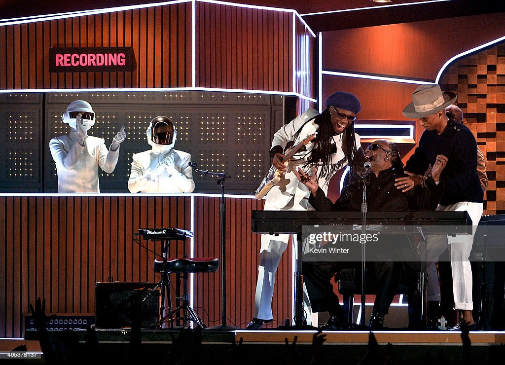 Musicians Daft Punk; <a gi-track='captionPersonalityLinkClicked' href=/galleries/search?phrase=Nile+Rodgers&family=editorial&specificpeople=217582 ng-click='$event.stopPropagation()'>Nile Rodgers</a>, <a gi-track='captionPersonalityLinkClicked' href=/galleries/search?phrase=Stevie+Wonder&family=editorial&specificpeople=171911 ng-click='$event.stopPropagation()'>Stevie Wonder</a> and <a gi-track='captionPersonalityLinkClicked' href=/galleries/search?phrase=Pharrell+Williams&family=editorial&specificpeople=161396 ng-click='$event.stopPropagation()'>Pharrell Williams</a> perform onstage during the 56th GRAMMY Awards at Staples Center on January 26, 2014 in Los Angeles, California.