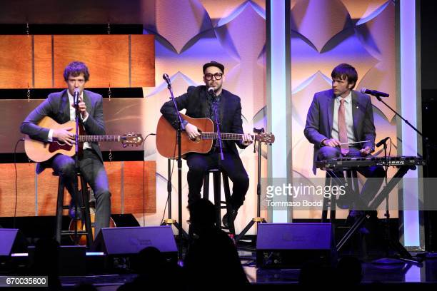 Musicians Damian Kulash Tim Nordwind and Andy Ross of OK Go perform onstage during the Thirst Project's 8th Annual thirst Gala at Beverly Hills Hotel...