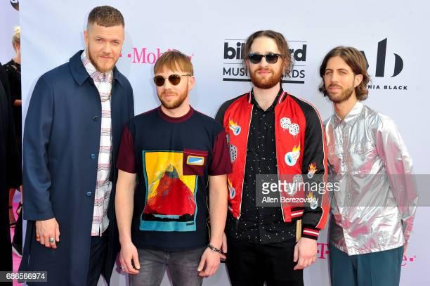 Musicians Dan Reynolds Ben McKee Daniel Platzman and Wayne Sermon of Imagine Dragons arrive at 2017 Billboard Music Awards at TMobile Arena on May 21...