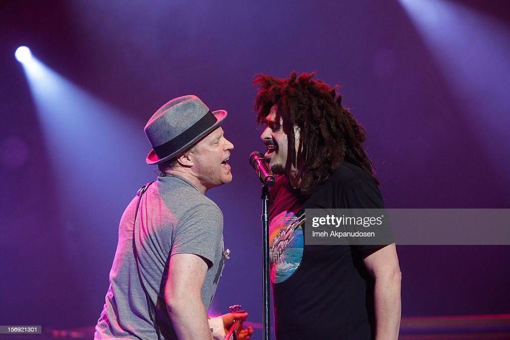 Musicians Dan Vickrey (L) and <a gi-track='captionPersonalityLinkClicked' href=/galleries/search?phrase=Adam+Duritz&family=editorial&specificpeople=207121 ng-click='$event.stopPropagation()'>Adam Duritz</a> of Counting Crows perform onstage at The Wiltern on November 24, 2012 in Los Angeles, California.