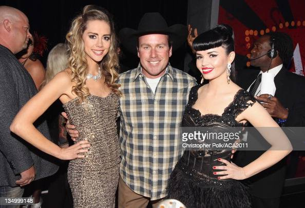 Musicians Danelle Leverett and Susie Brown of the Jane Dear Girls and Musician Rodney Carrington attends the American Country Awards 2011 at the MGM...