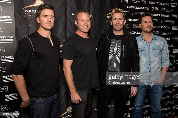 Musicians Daniel Adair Mike Kroeger Chad Kroeger and Ryan Peake of Nickelback pose backstage at House of Blues Sunset Strip on November 5 2014 in...