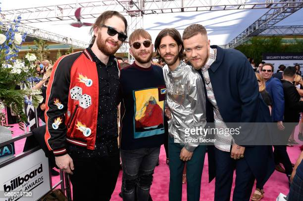 Musicians Daniel Platzman Ben McKee Wayne Sermon and Dan Reynolds of Imagine Dragons pose at SiriusXM's 'Hits 1 in Hollywood' red carpet broadcast on...