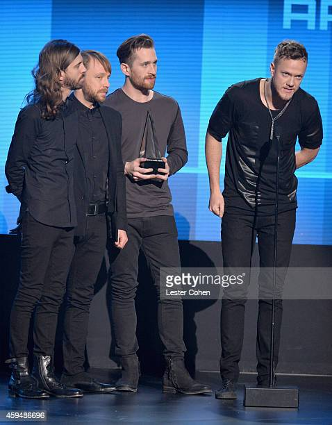 Musicians Daniel Wayne Sermon Ben McKee Daniel Platzman and Dan Reynolds of Imagine Dragons speak onstage at the 2014 American Music Awards at Nokia...