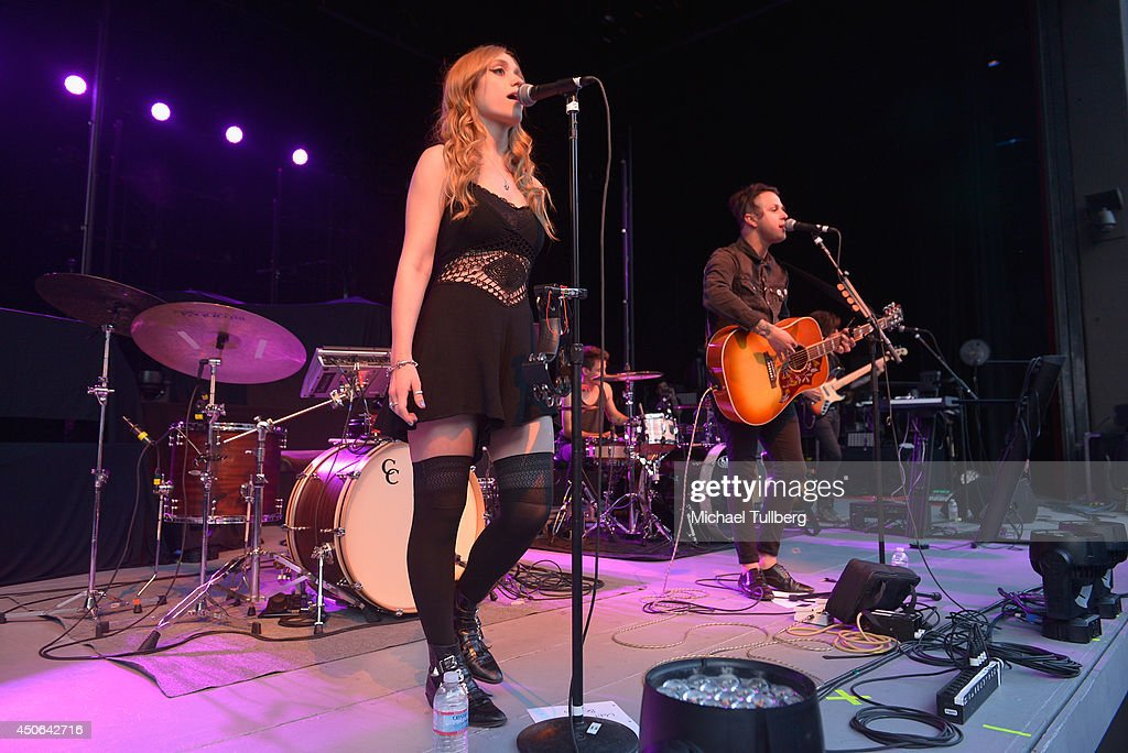 Musicians Danielle Bouchard and Mitchy Collins of the music group Oh Honey perform at The Greek Theatre on June 14, 2014 in Los Angeles, California.