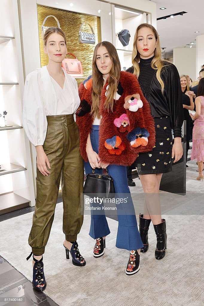 Musicians Danielle Haim Alana Haim and Este Haim attend Fendi And Vogue Celebrate Fendi Beverly Hills at Fendi on March 24 2016 in Beverly Hills...