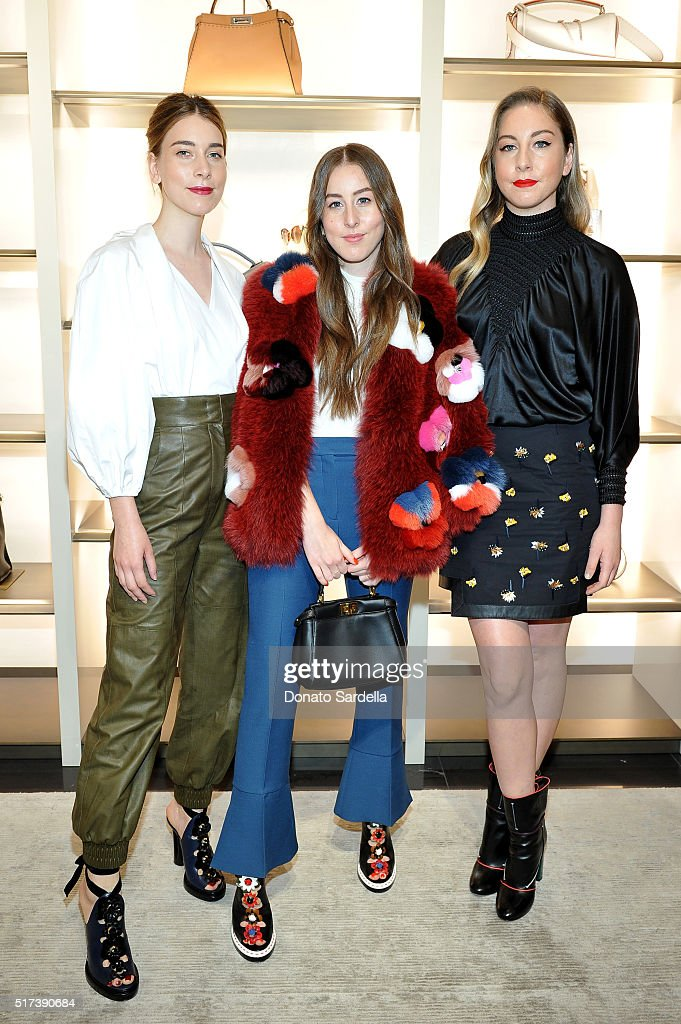 Musicians Danielle Haim Alana Haim and Este Haim of Haim attend Fendi and Vogue Celebrate Fendi Beverly Hills at Fendi on March 24 2016 in Beverly...