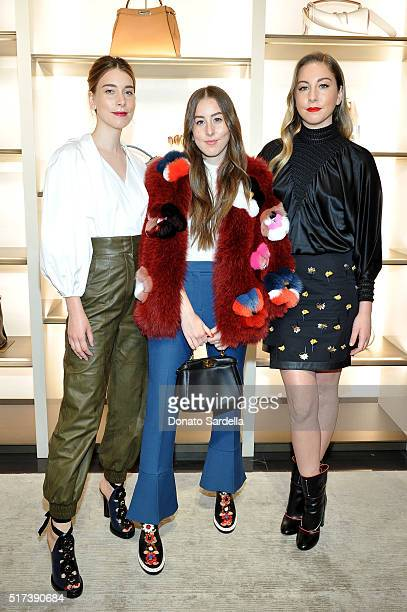 Musicians Danielle Haim Alana Haim and Este Haim of Haim attend Fendi and Vogue Celebrate Fendi Beverly Hills at Fendi on March 24 2016 in Beverly...