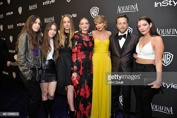 Musicians Danielle Haim Alana Haim and Este Haim of the rock band HAIM actress Jaime King Singersongwriter Taylor Swift InStyle Editor in Chief Ariel...