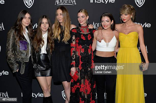 Musicians Danielle Haim Alana Haim and Este Haim of the rock band HAIM actress Jaime King and recording artists Lorde and Taylor Swift attend the...