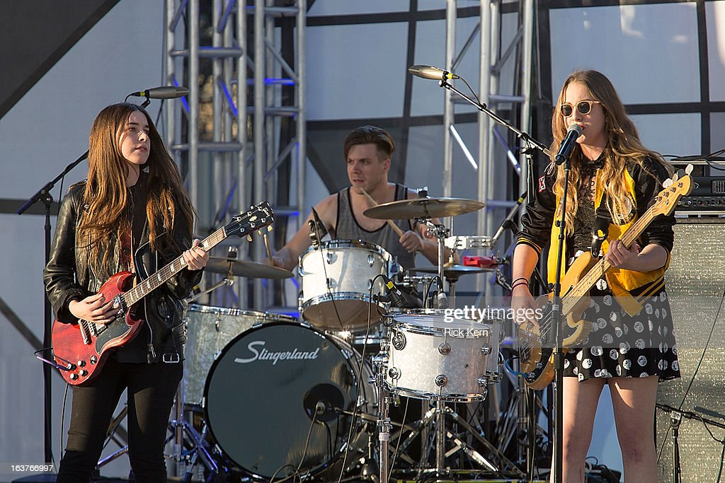 Musicians <a gi-track='captionPersonalityLinkClicked' href=/galleries/search?phrase=Danielle+Haim&family=editorial&specificpeople=2499485 ng-click='$event.stopPropagation()'>Danielle Haim</a>, Dash Hutton, and <a gi-track='captionPersonalityLinkClicked' href=/galleries/search?phrase=Este+Haim&family=editorial&specificpeople=2499486 ng-click='$event.stopPropagation()'>Este Haim</a> of Haim perform on stage during the 9th Annual mtvU Woodie Awards on March 14, 2013 in Austin, Texas.