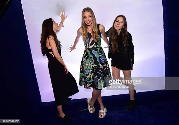 Musicians Danielle Haim Este Haim and Alana Haim attend the HM Loves Coachella Tent at the 2015 Coachella Valley Music Arts Festival at the Empire...