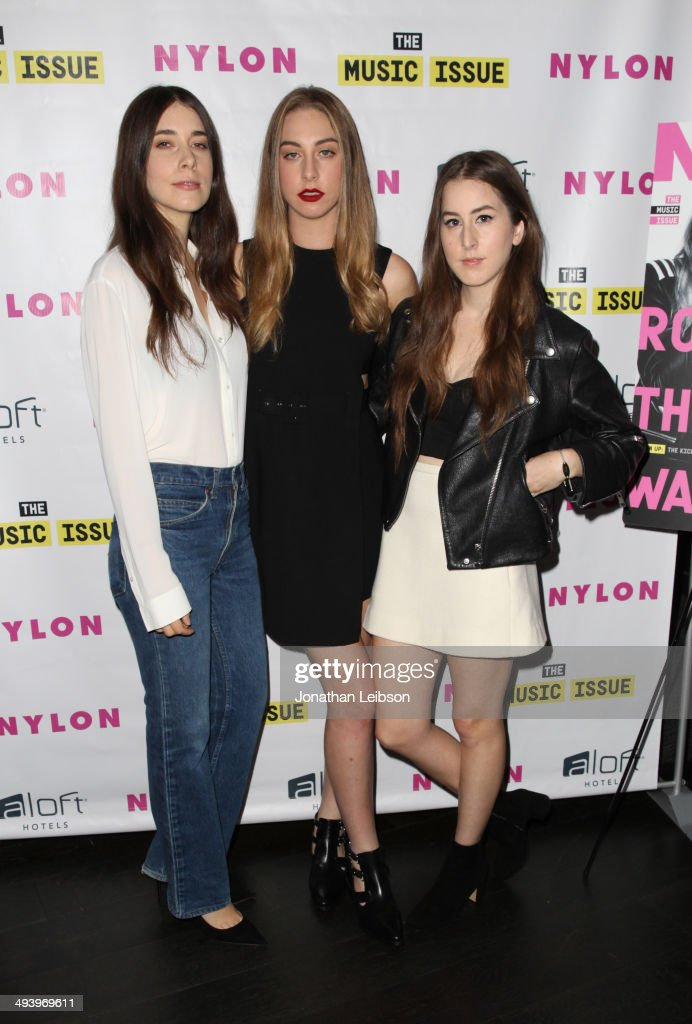 Musicians <a gi-track='captionPersonalityLinkClicked' href=/galleries/search?phrase=Danielle+Haim&family=editorial&specificpeople=2499485 ng-click='$event.stopPropagation()'>Danielle Haim</a>, <a gi-track='captionPersonalityLinkClicked' href=/galleries/search?phrase=Este+Haim&family=editorial&specificpeople=2499486 ng-click='$event.stopPropagation()'>Este Haim</a> and <a gi-track='captionPersonalityLinkClicked' href=/galleries/search?phrase=Alana+Haim&family=editorial&specificpeople=9431818 ng-click='$event.stopPropagation()'>Alana Haim</a> of HAIM attend NYLON x Aloft Hotels celebrate The Music Issue with cover star HAIM on May 26, 2014 in Los Angeles, California.