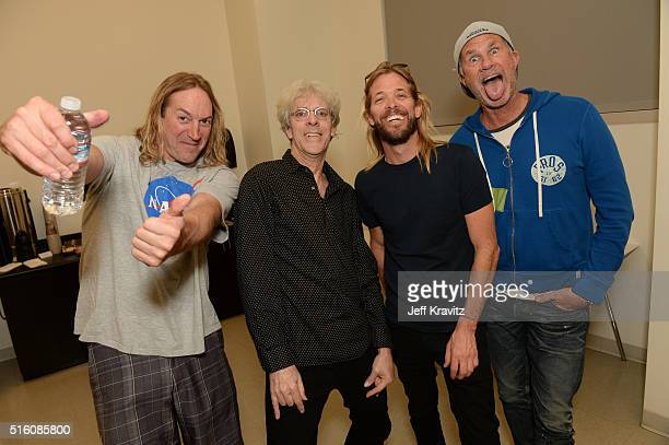 Musicians Danny Carey Stewart Copeland Taylor Hawkins and Chad Smith pose backstage during Stewart Copeland Presents 'BenHur A Tale Of The Christ' at...