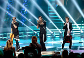 Musicians Danny Wood and Jordan Knight of NKOT and finalist Daniel Seavey perform onstage during 'American Idol' XIV Grand Finale at Dolby Theatre on...