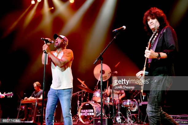 Musicians Darius Rucker and Tommy Thayer perform onstage during the 8th annual Darius Friends concert to benefit St Jude's Children's Research...