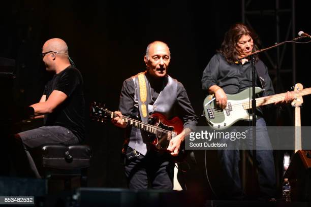 Musicians Darrel Smith Carlos Rios and Al Ortiz perform onstage with Stevie Nicks during the 2017 Bourbon Beyond Festival at Champions Park on...