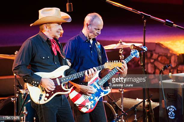 Musicians Dave Alvin and Wayne Kramer perform onstage at Ford Theatre on September 7 2013 in Hollywood California