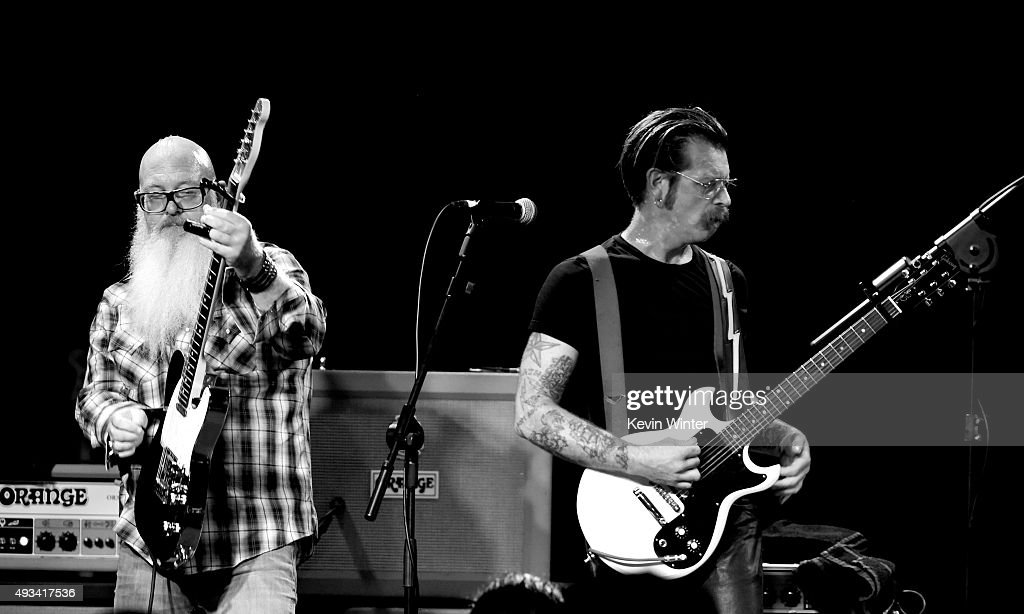 Musicians Dave Catching (L) and Jesse Hughes of Eagles of Death Metal perform at the Teragram Ballroom on October 19, 2015 in Los Angeles, California.
