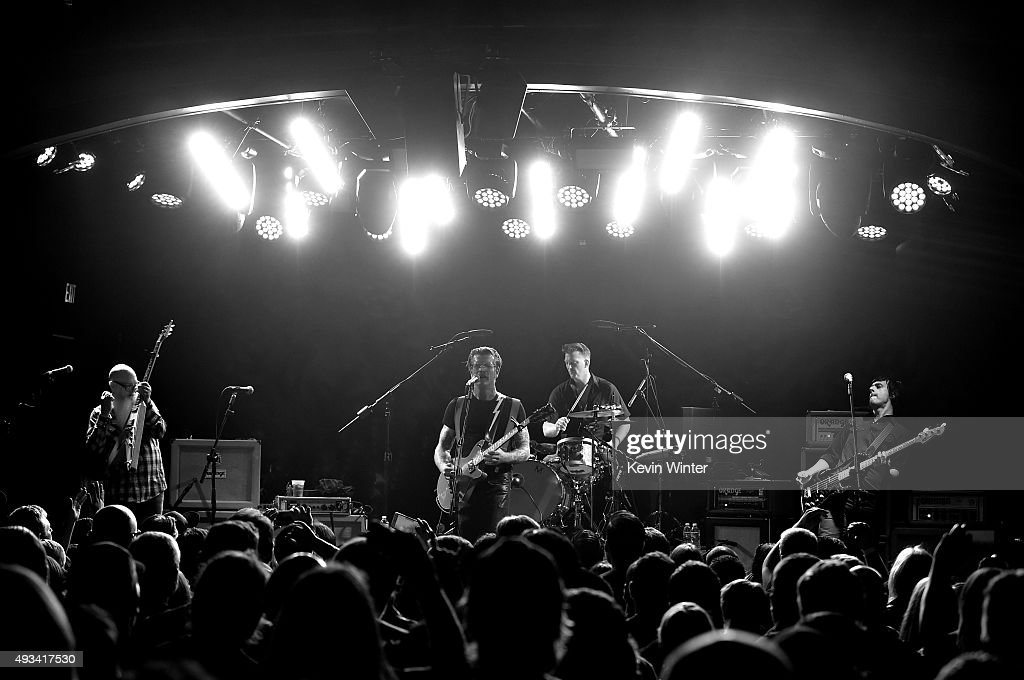 Musicians Dave Catching, Jesse Hughes, Josh Homme and Matt McJunkins of Eagles of Death Metal perform at the Teragram Ballroom on October 19, 2015 in Los Angeles, California.