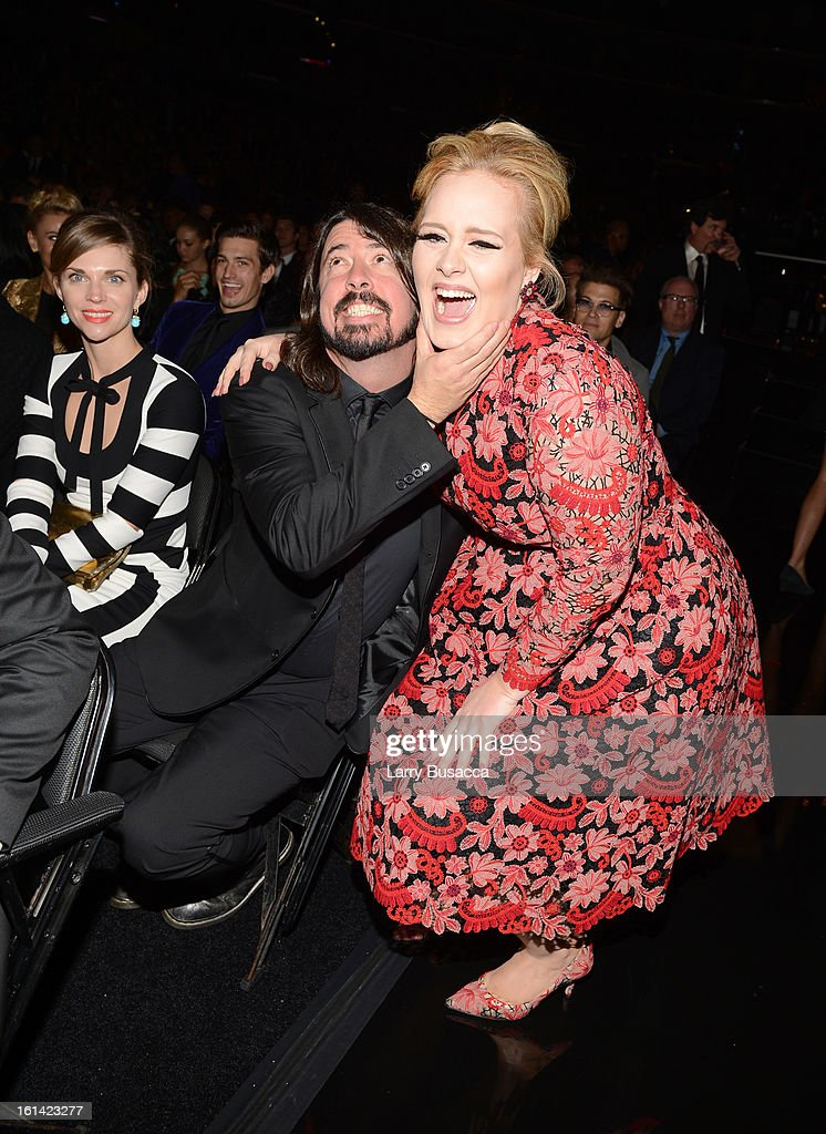 Musicians <a gi-track='captionPersonalityLinkClicked' href=/galleries/search?phrase=Dave+Grohl&family=editorial&specificpeople=202539 ng-click='$event.stopPropagation()'>Dave Grohl</a> (L) and <a gi-track='captionPersonalityLinkClicked' href=/galleries/search?phrase=Adele+-+Singer&family=editorial&specificpeople=4898935 ng-click='$event.stopPropagation()'>Adele</a> attend the 55th Annual GRAMMY Awards at STAPLES Center on February 10, 2013 in Los Angeles, California.