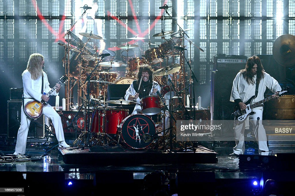 Musicians Dave Grohl and Taylor Hawkins of Foo Fighters and producer Nick Raskulinecz perform onstage at the 28th Annual Rock and Roll Hall of Fame Induction Ceremony at Nokia Theatre L.A. Live on April 18, 2013 in Los Angeles, California.