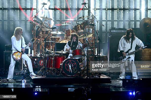 Musicians Dave Grohl and Taylor Hawkins of Foo Fighters and producer Nick Raskulinecz perform onstage at the 28th Annual Rock and Roll Hall of Fame...