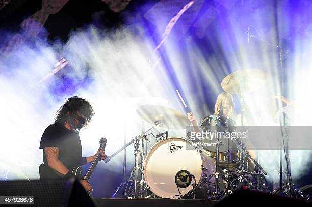 Musicians Dave Grohl and Taylor Hawkins of Foo Fighters perform onstage during day 3 of the 2014 Life is Beautiful festival on October 26 2014 in Las...