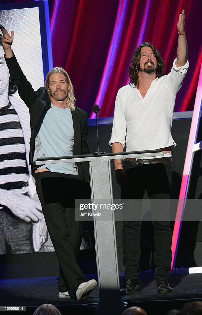 Musicians <a gi-track='captionPersonalityLinkClicked' href=/galleries/search?phrase=Dave+Grohl&family=editorial&specificpeople=202539 ng-click='$event.stopPropagation()'>Dave Grohl</a> (R) and <a gi-track='captionPersonalityLinkClicked' href=/galleries/search?phrase=Taylor+Hawkins&family=editorial&specificpeople=220594 ng-click='$event.stopPropagation()'>Taylor Hawkins</a> onstage at the 28th Annual Rock and Roll Hall of Fame Induction Ceremony at Nokia Theatre L.A. Live on April 18, 2013 in Los Angeles, California.
