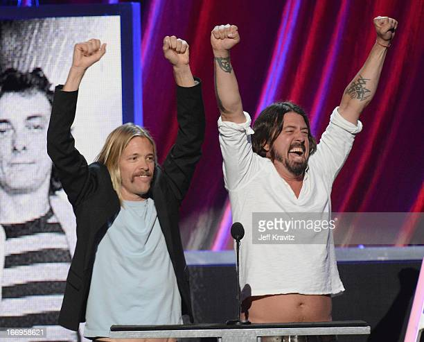 Musicians Dave Grohl and Taylor Hawkins onstage at the 28th Annual Rock and Roll Hall of Fame Induction Ceremony at Nokia Theatre LA Live on April 18...
