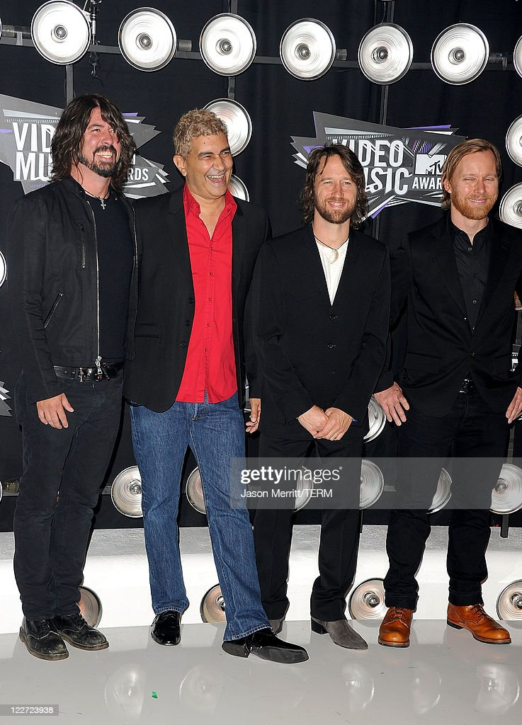 Musicians Dave Grohl, Pat Smear, Chris Shiflett and Nate Mendel of the band Foo Fighters arrive at the 2011 MTV Video Music Awards at Nokia Theatre L.A. LIVE on August 28, 2011 in Los Angeles, California.