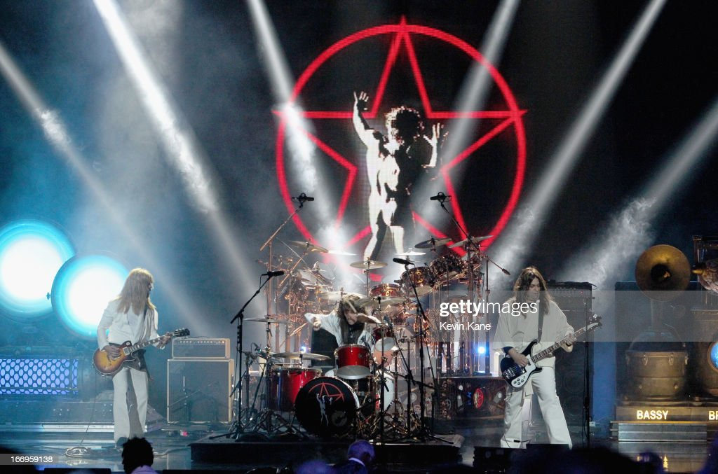 Musicians Dave Grohl, Taylor Hawkins and Nick Raskulinecz perform onstage during the 28th Annual Rock and Roll Hall of Fame Induction Ceremony at Nokia Theatre L.A. Live on April 18, 2013 in Los Angeles, California.