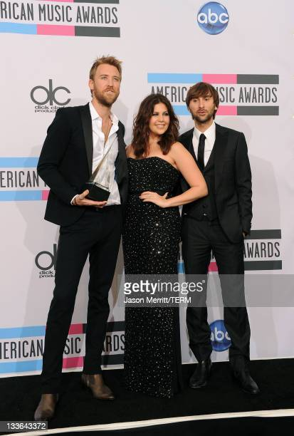 Musicians Dave Haywood Hillary Scott and Charles Kelley of Lady Antebellum winners of Favorite Country Band/Duo/Group Award pose in the press room at...