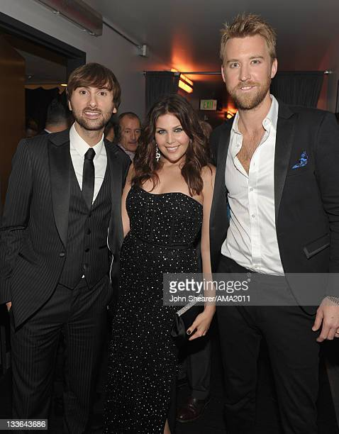 Musicians Dave Haywood Hillary Scott and Charles Kelley of the band Lady Antebellum backstage at the 2011 American Music Awards held at Nokia Theatre...