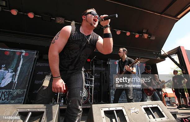 Musicians Dave Holowchak Terry Freers and Paul Delmotte of Ghosts of August perform during the 2012 Rock On The Range festival at Crew Stadium on May...