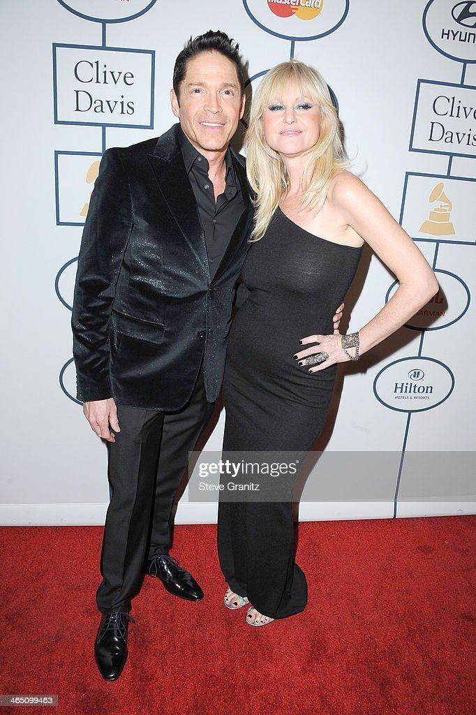 Musicians <a gi-track='captionPersonalityLinkClicked' href=/galleries/search?phrase=Dave+Koz&family=editorial&specificpeople=233633 ng-click='$event.stopPropagation()'>Dave Koz</a> (L) and Mindy Abair attend the 56th annual GRAMMY Awards Pre-GRAMMY Gala and Salute to Industry Icons honoring Lucian Grainge at The Beverly Hilton on January 25, 2014 in Los Angeles, California.