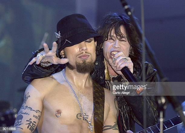 Musicians Dave Navarro and Steven Tyler perform during the 3rd Annual 'ten' fashion show and charity event to celebrate awards season and car culture...
