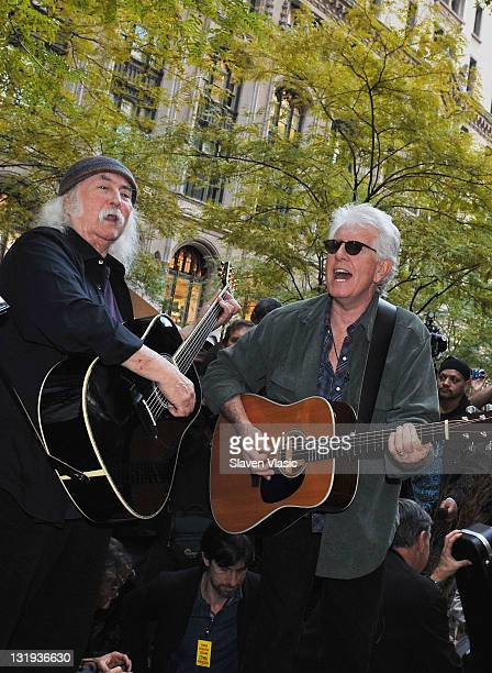 Musicians David Crosby and Graham Nash perform during the Occupy Wall Street protest at Zuccotti Park on November 8 2011 in New York City